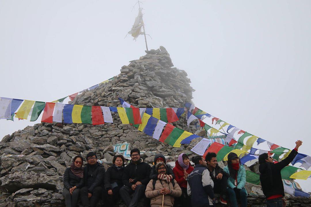 Group of Travelers Posing on the top of Ama Yangri